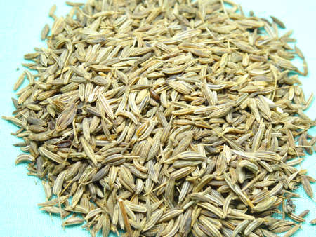 caraway: Caraway or Cumin Parsi scattered in light green background, photo taken in Malaysia Stock Photo