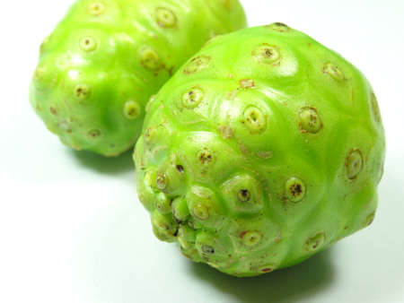great morinda: unripe  cheese fruit close up on white background, photo taken in Malaysia