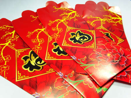 packets: chinese new year green packets close up in white background. Stock Photo