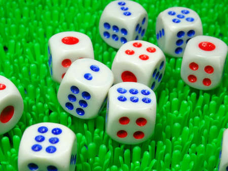dices: dices  on artificial green grass background Stock Photo