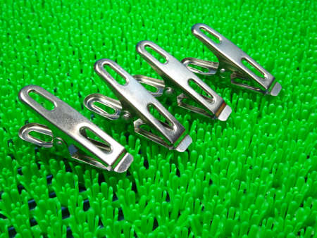 pegs: steel pegs on artificial green grass  background