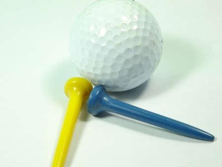 golf ball on tee: golf  ball tee on white background