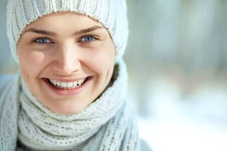 portrait of a smiling young girl in a hat and scarf photo