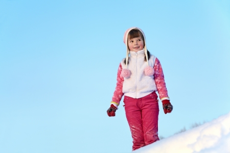 portrait of a girl walking around outdoors in the winter, looking to the side