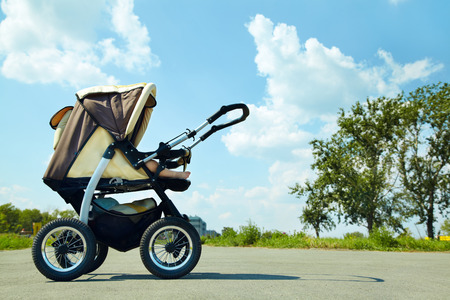 baby stroller: baby stroller on a walk in the park summer day