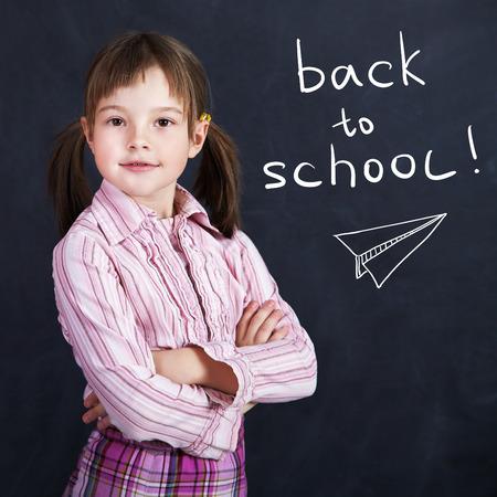 schoolchild: Portrait of a schoolchild on a background of the board. School and education