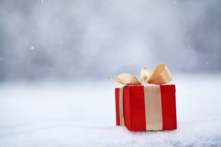 winter Christmas gift box in the snow outdoors.