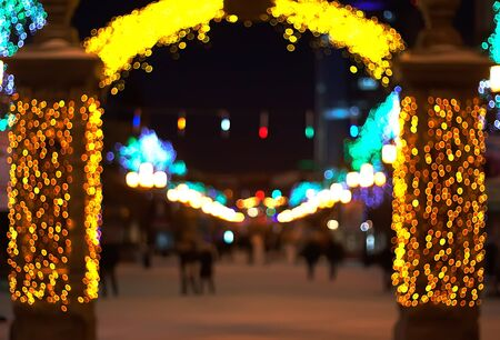 christmas in the city: blurred background. street decorated with festive lights. Christmas city outdoors Stock Photo