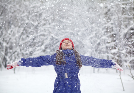 portrait of a girl walking in the winter outdoors. playing with snow. children outdoor Standard-Bild