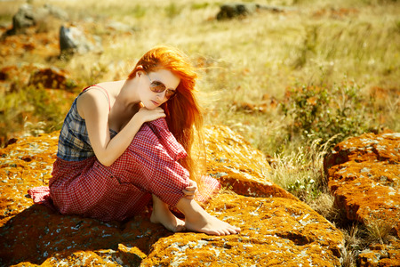 sexy redhead: sexy redhead woman in a dress outdoors. Beautiful stylish romantic young girl on nature background