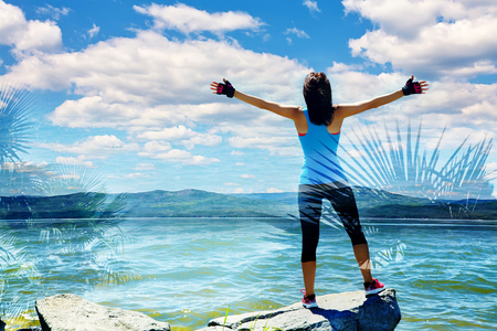 vastness: double exposure of athletic woman on the background of the sea. freedom and a healthy lifestyle. harmonious person outdoors. travel, nature and vastness of the ocean. freedom