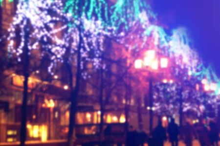 christmas in the city: blurred vintage background. trees decorated with lights on the street. Christmas city outdoors Stock Photo