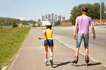 two people rollerblade Stock Photo