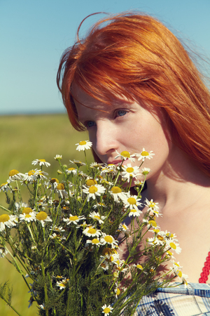 elegance fashion girls look sensuality young: redhead woman with flowers