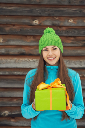 christmas backgrounds: woman with a gift in their hands Stock Photo