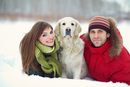 couple with a dog on winter