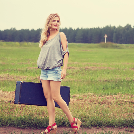 sexy woman with a suitcase Stockfoto