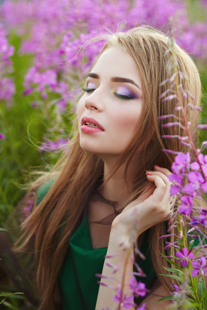 attractive girl in a field with flowers