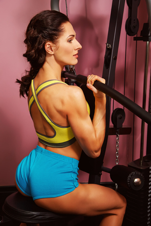 woman doing exercises on training apparatus in gym Stock fotó