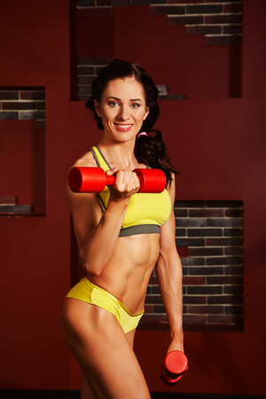 sporty attractive fitness woman with dumbbells in gym Stock fotó