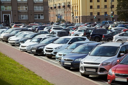 car park in the city center. a lot of cars on area