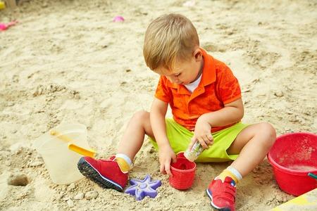 little boy on playground. playing child in sandbox