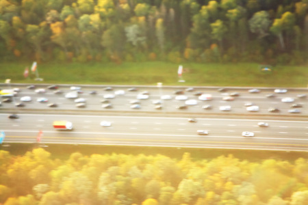 motorway out of city. going cars on the road top view. blurred background. Reklamní fotografie