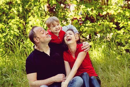 outdoor portrait of a happy family. Mom, dad and child.
