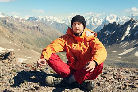 climber meditates on background of mountains. relaxed man outdoors Stock fotó
