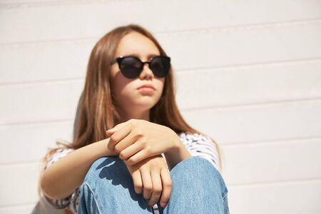 outdoor urban portrait of a stylish young woman in sunglasses.