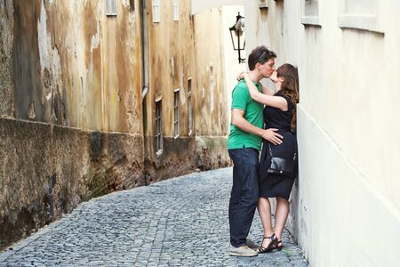 young couple in love walking on a street of European city. sightseeing traveler
