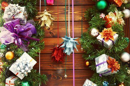 colorful wooden background with multicolored gift box and balls. decorations for xmas and New Year