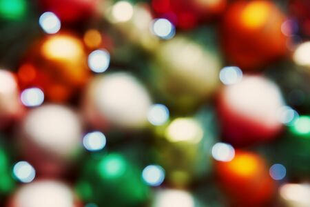 Decorations For Christmas.Multicolored Blurred Balls Background With Decorations For Christmas