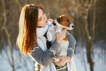 Jack Russell Terrier dog with owner in the winter outdoors