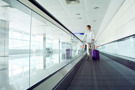 traveler man with a suitcase at airport.