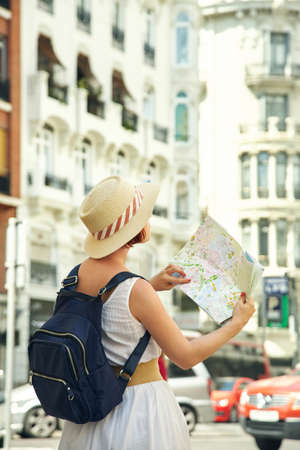 woman tourist looking map on a street of european city, travel to Valencia.