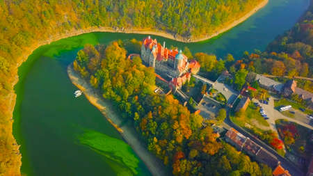 Wawel castle famous landmark in Krakow Poland. Picturesque landscape on coast river Wisla. Autumn sunset with white sky and cloud