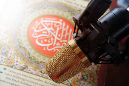 recite: quran and microphone recite Islamic holy book