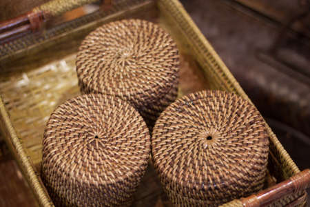 rattan or bamboo handicraft hand made from natural straw traditional basket container from Indonesia Asia Stock Photo