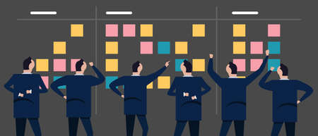 Employee businessman looking together at sticky notes planning concept of scrum agile in business