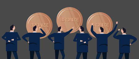Employee businessman looking together at bronze coins concept of precious metal investment in business