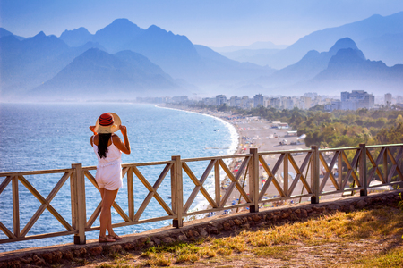 Fabulous beaches of the Turquoise Antalya coasts with mountain setting on the background Stock Photo