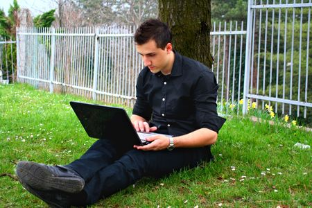 Young Businessman and Laptop 2 Stock Photo - 4612758