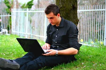 Young Businessman and Laptop photo