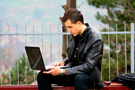 Young Businessman and Laptop 3 photo