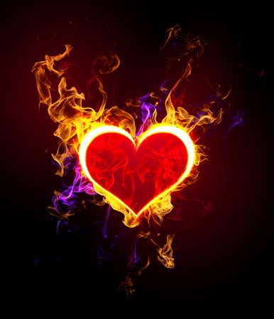quemadura: Silueta del coraz�n capturado por una llama de fuego sobre un fondo oscuro Foto de archivo