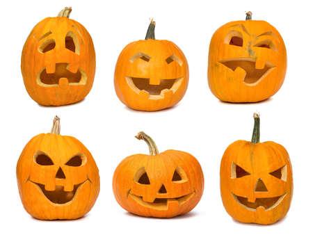carving pumpkin: Tallado Jack-o-linternas encendidas para Halloween. Aislado en blanco Foto de archivo