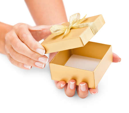 Hands holding an opened gift box isolated on white photo