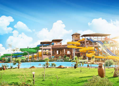 Colorful aquapark constructions in swimming-pool Editorial