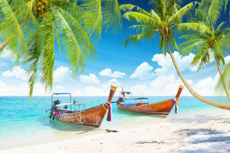 Tropical island with boats and a beautiful blue sky with clouds  photo